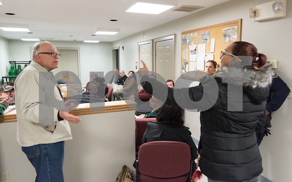 11/27/17 Wesley Bunnell | Staff Alderman Don Naples speaks with a concerned resident who only gave her first name as Anette at the North Oak NRZ meeting on Monday evening before State Attorney Brian Preleski spoke to the NRZ regarding the duties of his office.