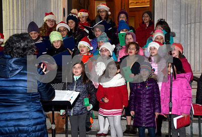 11/28/2017 Mike Orazzi | Staff St. Joseph Church Children and Youth Choir members during the 66th Annual Bristol Carol Sing and the 27th Holiday Lighting Ceremony in front of Webster Bank on Main Street in downtown Bristol Tuesday night.