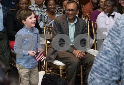 11/28/17   Wesley Bunnell | Staff  Twenty five new American Citizens took the Oath of Allegiance in an emotional ceremony given by The Honorable Judge Robert A. Richardson, United States Magistrate Judge for the District of Connecticut, in front of family and friends at the New Britain Museum of American Art on Tuesday afternoon.  A young boy smiles as he walks up to his mother Kate Strever-McCrossen who just received her certificate from the Honorable Judge Robert Richardson.