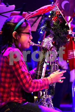12/17/2016 Mike Orazzi | Staff Ima Talipan performs during the 2nd Annual Tuba Christmas at Trinity-On-Main in downtown New Britain Saturday.