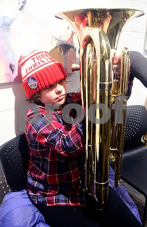 12/17/2016 Mike Orazzi | Staff Kate Chritton adds oil to a tuba during the 2nd Annual Tuba Christmas at Trinity-On-Main in downtown New Britain Saturday.