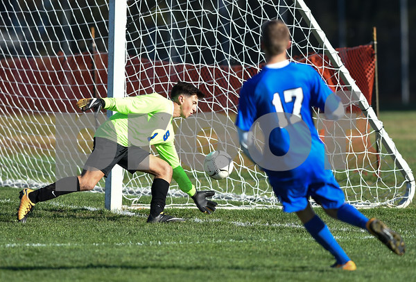 11/8/17 Wesley Bunnell   Staff Southington boys soccer was defeated in the CIAC tournament on Wednesday afternoon in a match against Glastonbury at Glastonbury High School. Goalkeeper Evan Daddona (1) and Hayden Burbank (17).