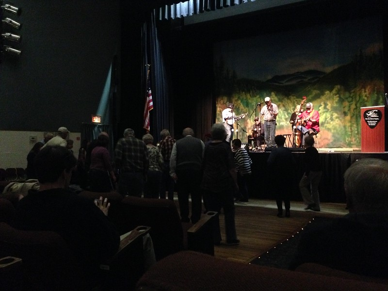 Tonight's band had a banjo, washboard, base, fiddle and a guitar. There were announcements and radio sponsors. The audience gets up and dances to most of the numbers. It's completely charming.