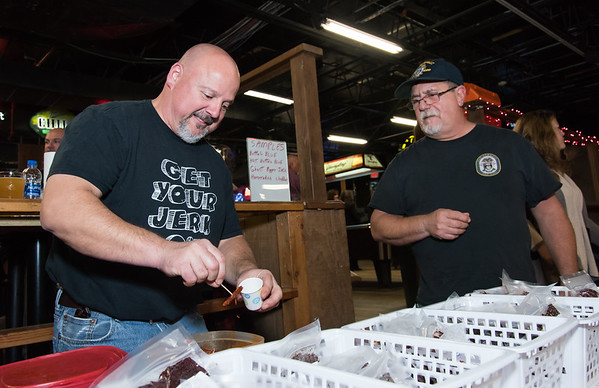 11/05/18 Wesley Bunnell | Staff The Southington Chamber of Commerce held their 13th annual Wing Fest on Monday evening at The Cadillac Ranch in Southington. Dan Baril from Mister B's Jerky Co serves Dan Cefaretti a sample of buffalo wing flavor jerky.