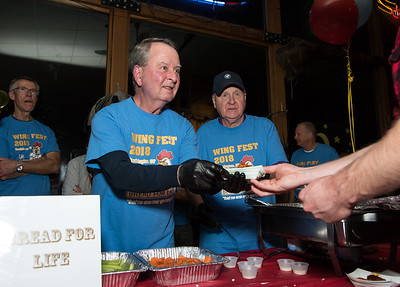 11/05/18  Wesley Bunnell | Staff  The Southington Chamber of Commerce held their 13th annual Wing Fest on Monday evening at The Cadillac Ranch in Southington. Pat Byrne, L, and Joe Campachiaro serve wings at the Bread for Life table.