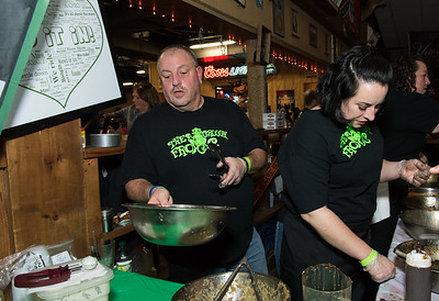 11/05/18  Wesley Bunnell | Staff  The Southington Chamber of Commerce held their 13th annual Wing Fest on Monday evening at The Cadillac Ranch in Southington.  Mark Montana , L and Carole Fazzina serve up wings at the Groggy Frog table.