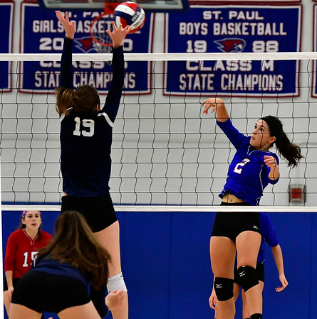11/7/2018 Mike Orazzi | Staff St. Paul Catholic High School's Greta Panke (2) and Immaculate's Finan Deakin (19) during the Class S Second Round Girls Volleyball Tournament in Bristol Wednesday night.