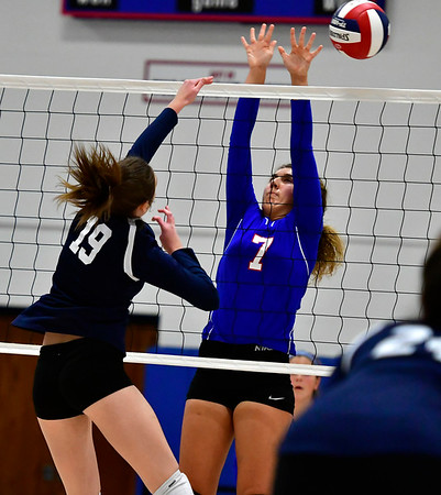 11/7/2018 Mike Orazzi | Staff St. Paul Catholic High School's Rebecca Nerbonne (7) and Immaculate's Finan Deakin (19) during the Class S Second Round Girls Volleyball Tournament in Bristol Wednesday night.