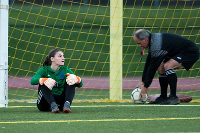 11/07/18  Wesley Bunnell | Staff  Southington girl soccer was defeated in PK by Simsbury in a second round Class LL CIAC Tournament game on Wednesday night. GK Olivia Sherwood (1) sits and looks over as Simsbury players celebrate their victory in PK's.