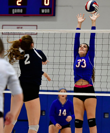 11/7/2018 Mike Orazzi | Staff St. Paul Catholic High School's Kelsi Blatchley (33) and Immaculate's Gabby Rynne (2) during the Class S Second Round Girls Volleyball Tournament in Bristol Wednesday night.