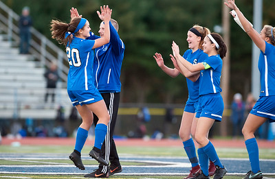 11/07/18  Wesley Bunnell | Staff  Southington girl soccer was defeated in PK by Simsbury in a second round Class LL CIAC Tournament game on Wednesday night. Katherine Crouse (20) is congratulated by teammates after scoring during PK's.