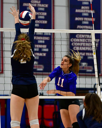 11/7/2018 Mike Orazzi | Staff St. Paul Catholic High School's Olivia Genovese (11) and Immaculate's Gabby Rynne (2) during the Class S Second Round Girls Volleyball Tournament in Bristol Wednesday night.