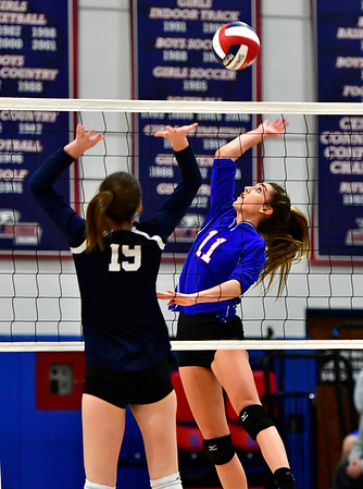 11/7/2018 Mike Orazzi | Staff St. Paul Catholic High School's Olivia Genovese (11) and Immaculate's Finan Deakin (19) during the Class S Second Round Girls Volleyball Tournament in Bristol Wednesday night.