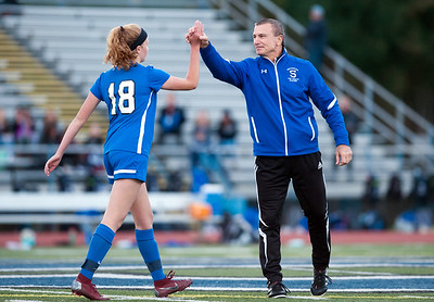 11/07/18  Wesley Bunnell | Staff  Southington girl soccer was defeated in PK by Simsbury in a second round Class LL CIAC Tournament game on Wednesday night. Abby Sowa (18) is met by Head coach Mike Linehan after scoring a goal in PK's.