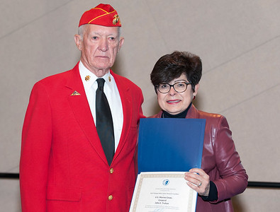 11/12/18  Wesley Bunnell | Staff  CCSU held a Veterans Day Observance on Monday afternoon in Alumni Hall which featured honoring three local veterans.  USMC Corporal Jack Truhan poses with CCSU President Zulma Toro.