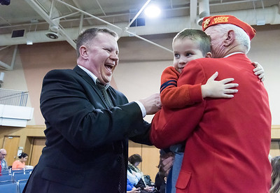 11/12/18  Wesley Bunnell | Staff  CCSU held a Veterans Day Observance on Monday afternoon in Alumni Hall which featured honoring three local veterans.  John R. Truhan, L, congratulates his father Jack Truhan after Jack received his award and came back to this seat to pick up grandson Andrew, age 2.