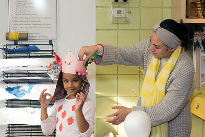 11/12/18  Wesley Bunnell | Staff  Rosa Farias helps her daughter Zoe Farias, age 6, try on her crown Zoe made during art class at Image Nation on Monday afternoon.