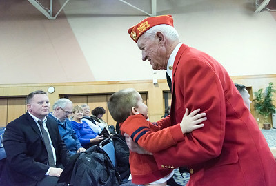11/12/18  Wesley Bunnell | Staff  CCSU held a Veterans Day Observance on Monday afternoon in Alumni Hall which featured honoring three local veterans. Honoree Jack Truhan picks up his grandson Andrew, age 2, after receiving his award.