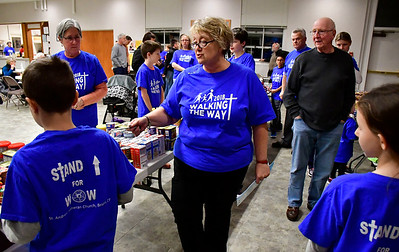 11/13/2018 Mike Orazzi | Staff Arlene Creswell directs volunteers at St. Andrew Lutheran Church as they fill bags with donated food for area homeless on Tuesday night in Bristol.