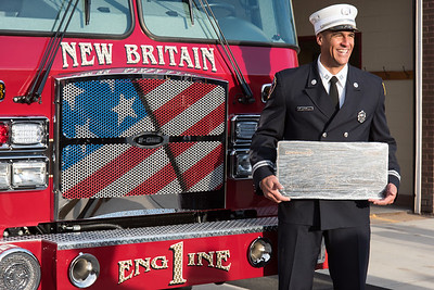 11/14/18  Wesley Bunnell | Staff  The New Britain Fire Department unveiled three new fire trucks on Wednesday afternoon during a ceremony at their Beaver St headquarters. Captain Ricardo Mickens stands in front of Engine 1.
