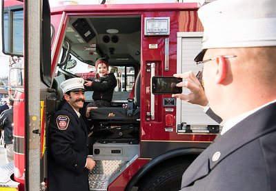 11/14/18  Wesley Bunnell | Staff  The New Britain Fire Department unveiled three new fire trucks on Wednesday afternoon during a ceremony at their Beaver St headquarters. Lt. Nick Papa poses for a photo with his 2 year old son Tommy.