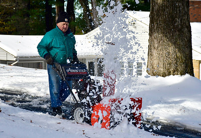 11/16/2018 Mike Orazzi | Staff Mike Thomas clears snow along Rogers Road in Bristol while cleaning up from Thursday's storm in Bristol.