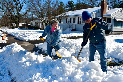 11/16/2018 Mike Orazzi | Staff Cathy and Wilbur Roys shovel a sidewalk along Louisiana Avenue in Bristol while cleaning up from Thursday's storm.