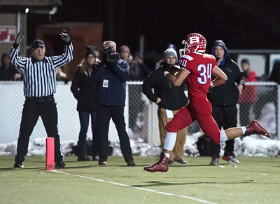 11/16/18  Wesley Bunnell | Staff  New Britain vs Berlin football at Sage Park on Friday night. Alex Halkias (34) with a touchdown run.