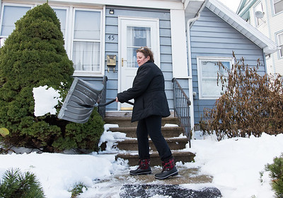 11/16/18  Wesley Bunnell | Staff  Sandra Ballard of New Britain cleans up the stairs at her home on Friday afternoon following the first winter storm of the season which lasted from last Thursday until Friday morning.