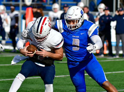 11/17/2018 Mike Orazzi | Staff CCSU's Kenneth Keen (9) and Duquesne's Daniel Parr (13) at Arute Field in New Britain Saturday afternoon.