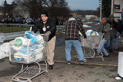 11/19/18  Wesley Bunnell | Staff  HRA distributed Thanksgiving meals at their Osgood Ave location on Monday afternoon. Dalvin Ramirez, L, pushes a cart full of frozen turkeys.
