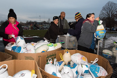11/19/18  Wesley Bunnell | Staff  HRA distributed Thanksgiving meals at their Osgood Ave location on Monday afternoon.  Maribel Candelaria, L, and fellow volunteers stack frozen turkeys.