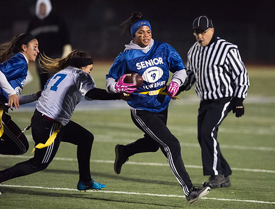 11/20/18  Wesley Bunnell | Staff  Plainville Seniors vs Juniors in powder puff football on Tuesday night at Plainville High School. Sydni Spencer carries the ball for the seniors.