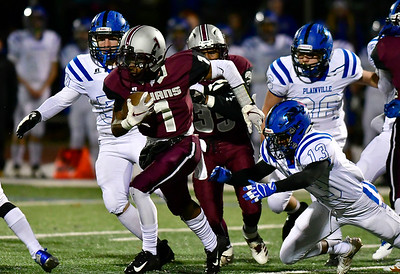 11/211/21/2018 Mike Orazzi | Staff Plainville's Fabi Laoz (13) and Farmington's Zihare Greaves (1) during Wednesday night's football game at Farmington High School.