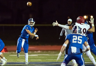 11/21/18  Wesley Bunnell | Staff  Southington vs Cheshire on Wednesday night at Southington High School. Jacob Drena (7) passes to Tanner LaRosa (25).