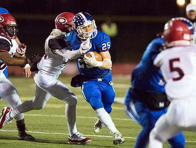 11/21/18  Wesley Bunnell | Staff  Southington vs Cheshire on Wednesday night at Southington High School. Tanner Larosa (25) with the carry.