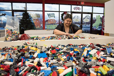 11/21/18  Wesley Bunnell | Staff  Customer Dina Dygan from Massachusetts sorts through bins of assorted lego pieces for sale at Bricks & Minifigs in Southington on Wednesday afternoon.