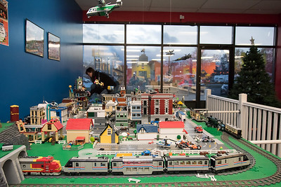 11/21/18  Wesley Bunnell | Staff  Owner of Bricks and Minifigs in Southington Traci Schneider works on converting a city carnival display into a winter village display at her store on Wednesday afternoon ahead of the upcoming holiday shopping season.