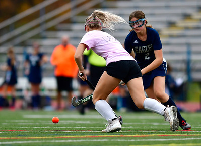 11/2/2018 Mike Orazzi | Staff Wethersfield's Zoe Kleeblatt (2) and Southington's Anna Laone (1) during field hockey at Southington High School Friday.