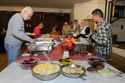 11/22/18  Wesley Bunnell | Staff  The Bristol Polish American Club held a Thanksgiving dinner for area veterans. Veteran Joe Perkins, L, of New Britain prepares a plate of food.