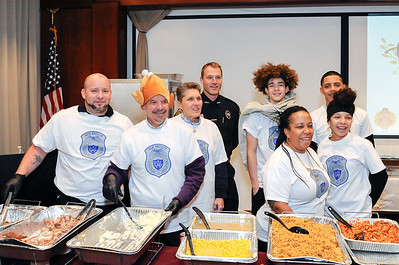 11/22/18  Wesley Bunnell | Staff  The New Britain Police Department with the help of several area businesses and efforts from their stuff a cruiser events held a Thanksgiving Dinner at police headquarters.  Several department members helped cook for the dinner. Volunteers pose for a photo include Adlerman Francisco Santiago, L, Raymond Szajkowski, Alice Kondracki and Ofc. Barry Hertzler.