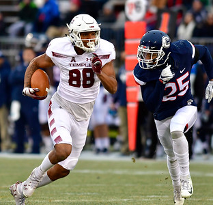 11/24/2018 Mike Orazzi | Staff UConn's Tyler Coyle (25) and Temple's Braden Mack (88) during Saturday's football at Rentschler Field in East Hartford.