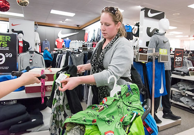 11/26/18  Wesley Bunnell | Staff  Ashley Kelley of New Britain has items price checked by Assistant Manager Melissa Hugel at Kohl's in Plainville on Monday afternoon.
