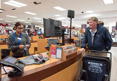 11/26/18  Wesley Bunnell | Staff  Ron Angelone of Southington is assisted by Kohl's cashier Naiaris Otero as he shops in their Plainville store on Monday afternoon.