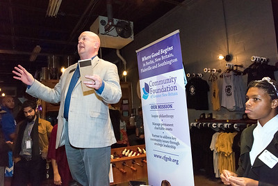 11/27/18  Wesley Bunnell | Staff  Community Foundation of Greater New Britain President David Obedzinski, L, speaks to the crowd at Alvarium Brewery on Tuesday night.  The Community Foundation of Greater New Britain along with several community foundations were on hand to meet and speak with guests about becoming involved during the Day of Giving.