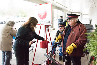 11/27/18  Wesley Bunnell | Staff  Melissa French of Terryville donates to the Salvation Army outside of Walmart in Bristol on Tuesday afternoon as Paul Morgan, L, and his father Clayton Morgan Jr. work as bell ringers.