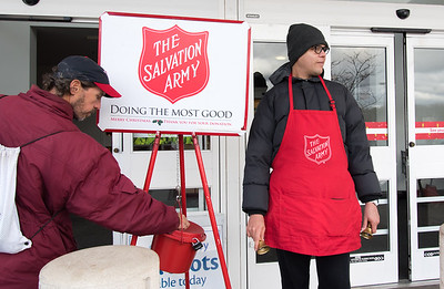 11/27/18  Wesley Bunnell | Staff  Keith Lagasse, donates to the Salvation Army outside of Stop & Shop in Berlin as Angel Gaud Reyes works as a bell ringer.