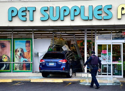 11/28/2018 Mike Orazzi | Staff  The scene at the Pet Supplies Plus on Farmington Avenue after the driver of a Subaru Outback drove through the storefront in Bristol Wednesday narrowly missing cashiers at their registers. No injuries were reported.