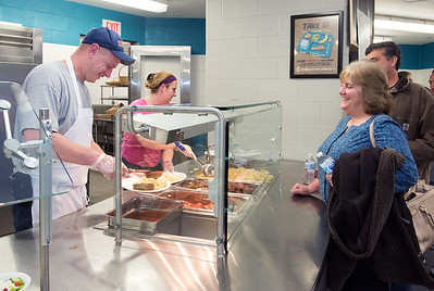 11/29/18  Wesley Bunnell | Staff  A fundraiser in support of Berlin Police Ofc. Aimee Krzykowski, a 14 year veteran officer, who's is battling breast cancer was held at Berlin High School on Thursday night.  Berlin Dispatcher Tom Farr, L, prepares a plate of pasta for Diane Jorsey of Berlin.