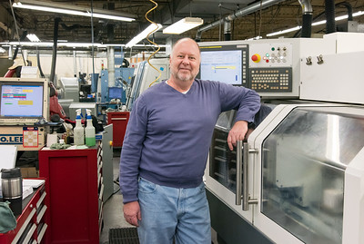 11/29/18  Wesley Bunnell | Staff   President of the Gammons Hoagland Company Paul Stefanik III stands in front of a grinding machine which was recently purchased with a grant from CT Manufacturing's Innovation Fund Voucher Program, MVP.